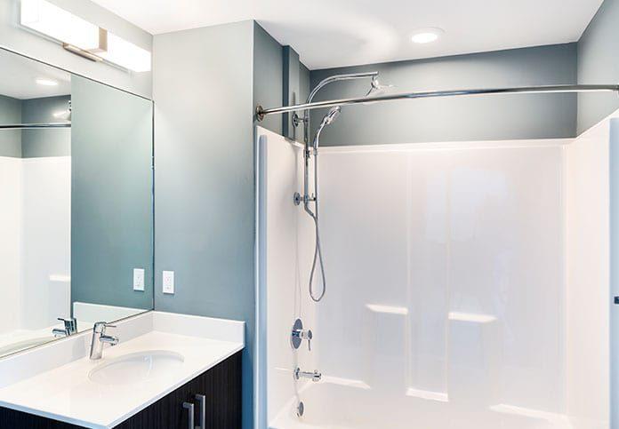 Elegant bathroom with vanity mirror and shower