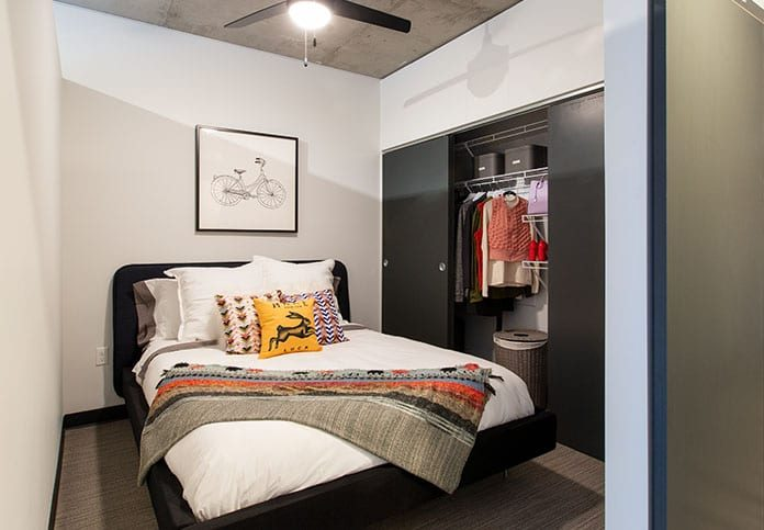 Bedroom with closet and ceiling fan